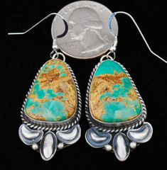 Navajo Sterling hanger earrings with Royston, Nevada turquoise and repousse' by Augustine Largo. SOLD!