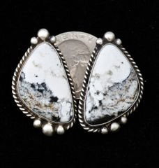 White Buffalo Sterling post earrings by Augustine Largo, Navajo.