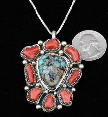 Navajo dead-pawn Sterling pendant with turquoise and Mediterranean blood-red branch coral.