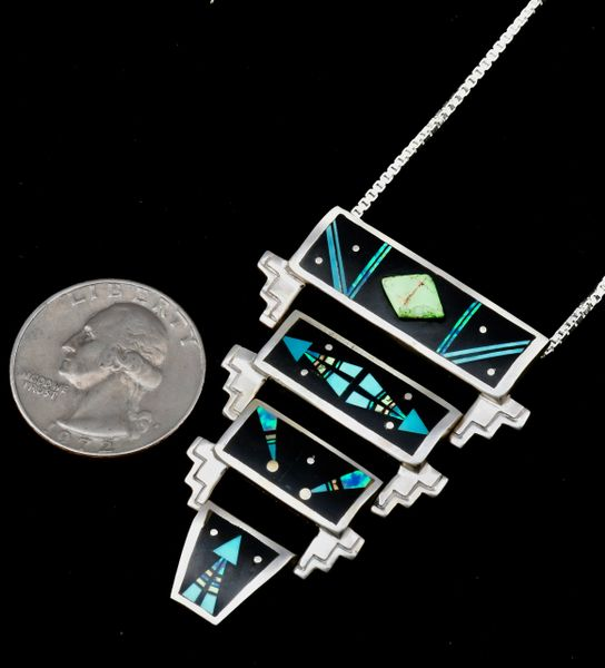 Zuni dead-pawn hinged, four-tiered inlay pendant.