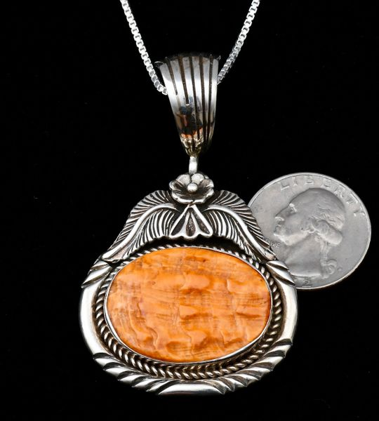 Somewhat older Sterling Navajo pendant with minimally-buffed orange spiney oyster setting, by Ted Joe.