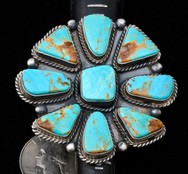 Size 8 large Navajo Sterling cluster ring containing nine Kingman, Arizona turquoise stones with distinct copper matrix, by Augustine Largo.