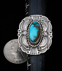 Size 8.5 Navajo dead-pawn Sterling ring with single turquoise stone.