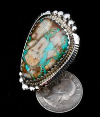 Size 8 Sterling Navajo ring with ribbon (boulder) turquoise, by Augustine Largo.