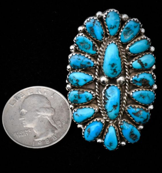 Size 7.75 dead-pawn Zuni-style cluster ring with 18 pristine Sleeping Beauty turquoise stones.