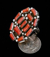 Size 8.5 Sterling Navajo cluster ring with thirteen pieces of real branch coral.