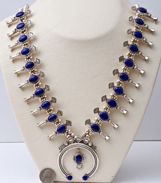Sterling Navajo squash blossom necklace with 20 real lapis stones.