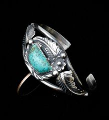 Dead-pawn Navajo Sterling cuff with single turquoise stone.