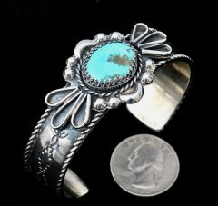 Navajo dead-pawn Sterling cuff with single Royston, Nevada turquoise stone.