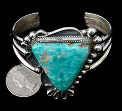 Sterling Navajo cuff with large triangular turquoise stone.