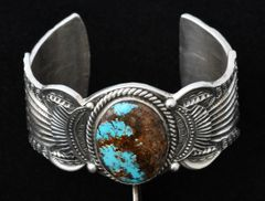 Larger wrist size Navajo heavy-silver cuff with single turquoise stone.