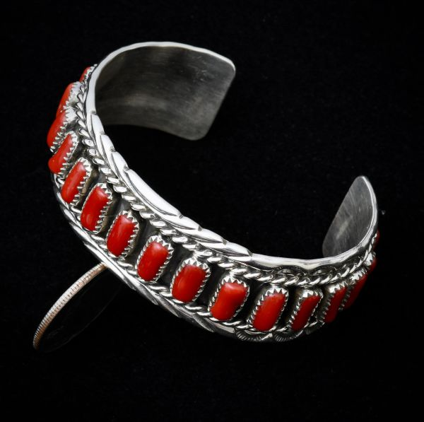 Sterling Navajo dead-pawn cuff with 19 pieces of Mediterranean red coral.