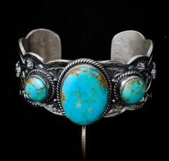 Sterling Navajo triplet cuff with Kingman turquoise.