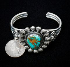 Small wrist-size intricate Sterling Navajo cuff with Royston turquoise.