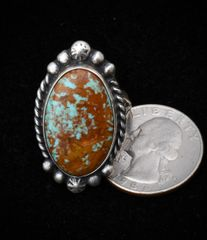 Size 8 Sterling navajo ring with heavy copper-matrix Royston turquoise.