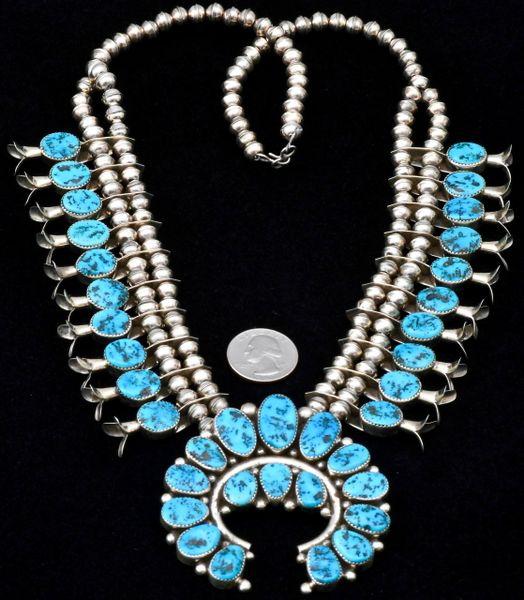 Dead-pawn Navajo Sterling squash-blossom necklace with 36 Sleeping Beauty turquoise stones, by Charlie Bowie.