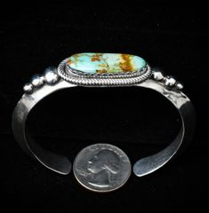 Navajo heavy silver cuff with single Royston, Nevada stone.
