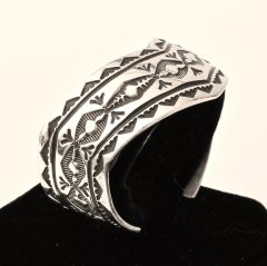 Serpentine-shaped and hand-stamped Sterling Navajo cuff.—SOLD!