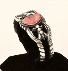 Navajo stamped sandcast Sterling Navajo cuff with spiney oyster shell.
