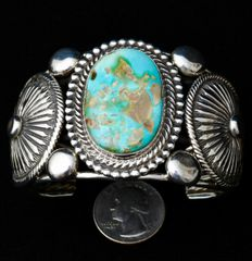 Navajo cuff with two exquisite Sterling conchos and Royston turquoise.
