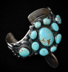 """Sterling Navajo cuff with eleven original """"old"""" No. 8 Mine turquoise stones, by Gilbert Tom."""