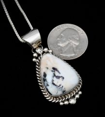 Smaller size Sterling Navajo pendant with premium white buffalo stone and Sterling chain.