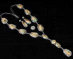 "Sterling Navajo ""lariat"" necklace set with fourteen ribbon turquoise stones, by Gilbert Tom."