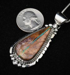 Sterling Navajo pendant with ribbon turquoise, by Augustine Largo.—SALE PENDING!