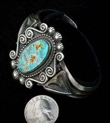 Intricate Sterling Navajo cuff with Turquoise Mountain mine turquoise.