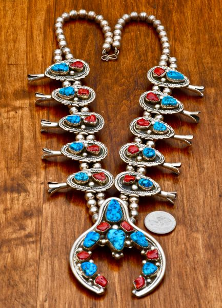 Intricate Navajo dead-pawn squash blossom necklace with Sleeping Beauty turquoise and Mediterranean red coral.