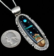 Sterling pendant with high desert night sky inlay.