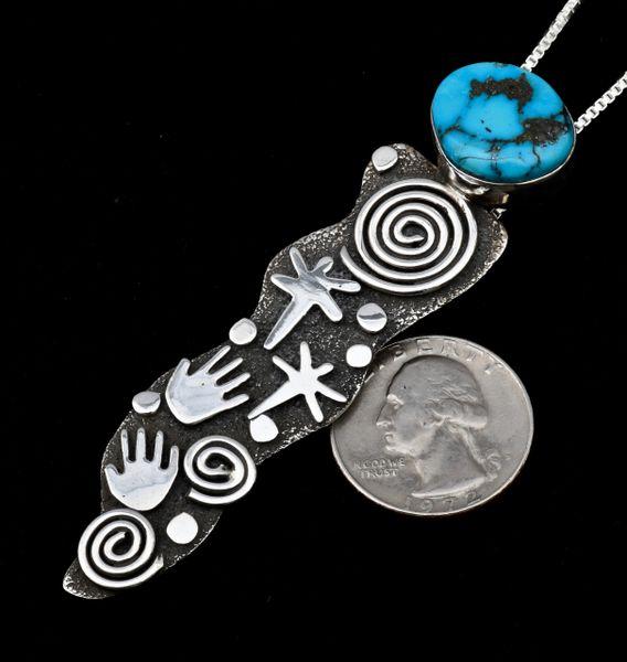 "Alex Sanchez' ""petroglyph-style"" Navajo Sterling pendant."