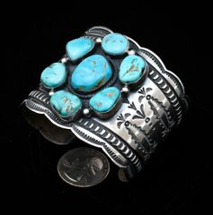 Finely-stamped Andy Cadman Sterling Navajo cuff with seven Royston, Nevada turquoise stones.