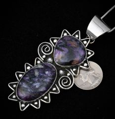 Large Sterling pendant by Chimney Butte with two stunning pieces of sugilite.