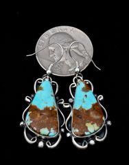 Sterling Navajo earrings with near-bookend match copper matrix turquoise.