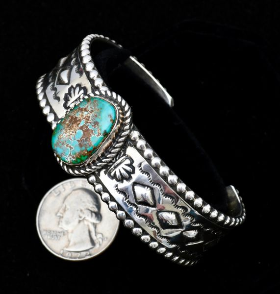 Size 6 and 7/8th's hand-stamped Sterling navajo cuff with single turquoise stone.