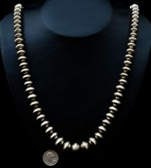 Vintage 31-inch actual Navajo graduated Sterling 73-bead necklace.