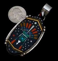 Pendant with night-time inlay scene by Michael Jack.