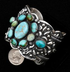 Bold and beautiful Sterling Navajo cluster cuff with mixed turquoise and generous repousse' by Gilbert Tom.