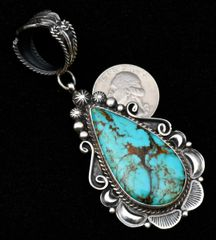 "Sterling Navajo pendant finished in ""old-style"" patina, with Kingman, Arizona turquoise."