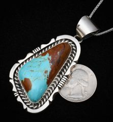 Heavy-silver Navajo pendant (and chain) with Kingman turquoise with copper matrix.
