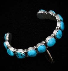 Classic dead-pawn Navajo 12-stone row cuff with Sleeping Beauty turquoise.