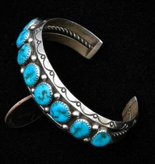 Dead-pawn Sterling Navajo row-cuff with Sleeping Beauty turquoise.