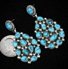 Sterling Navajo two-piece cluster earrings with Sleeping Beauty turquoise.