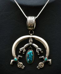 "Sterling silver kachina figure ""naja"" with turquoise and chain."