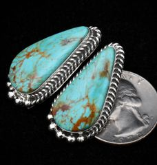 Sterling Navajo Kingman turquoise earrings with beautiful copper matrix.
