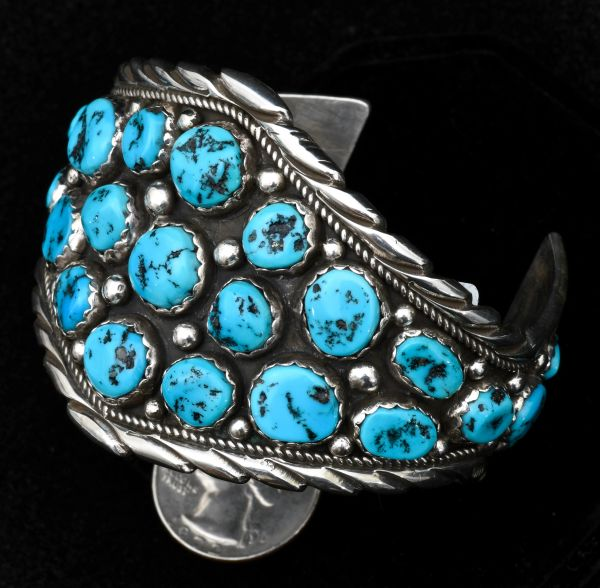 Sterling Navajo dead-pawn cuff with 25 Sleeping Beauty turquoise stones.