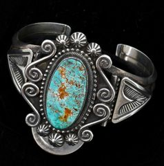 Sterling cuff with single turquoise stone and elaborate silversmithing by Jesse Martinez, Navajo.