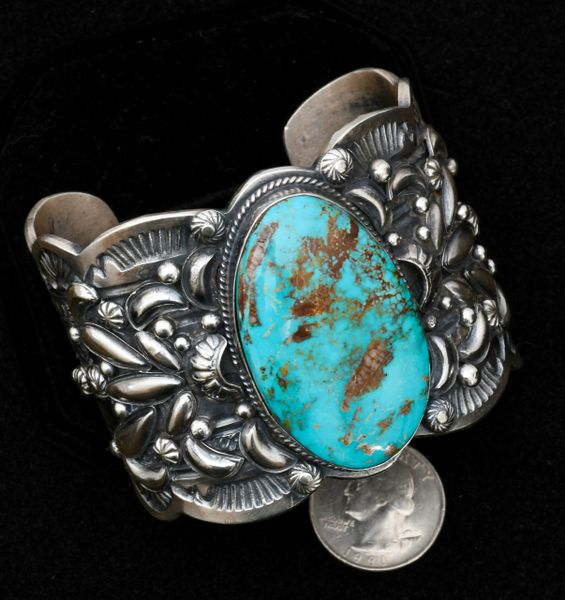 Seven-inch wrist size Sterling Navajo cuff with elaborate repousse' and hand-stamping, by Gilbert Tom.—SOLD!