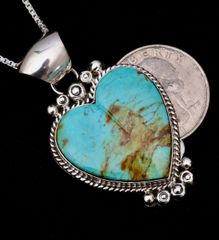 Heart-stopping Sterling Navajo heart-shaped pendant with Kingman, Arizona turquoise.